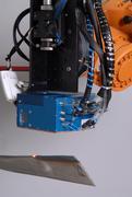 """Scanneroptik """"LASSY"""" an einem Roboter mit einem  Hochleistungsdiodenlaser zum Härten von Turbinenschaufeln  (Verschleißschutz)"""