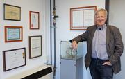 Professor Laurens Molenkamp with some of the numerous award certificates he has received over the past years.