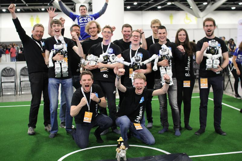 he B-Human team celebrating a few minutes after the win of the Standard Platform League Competition at RoboCup 2019 in Sydney.