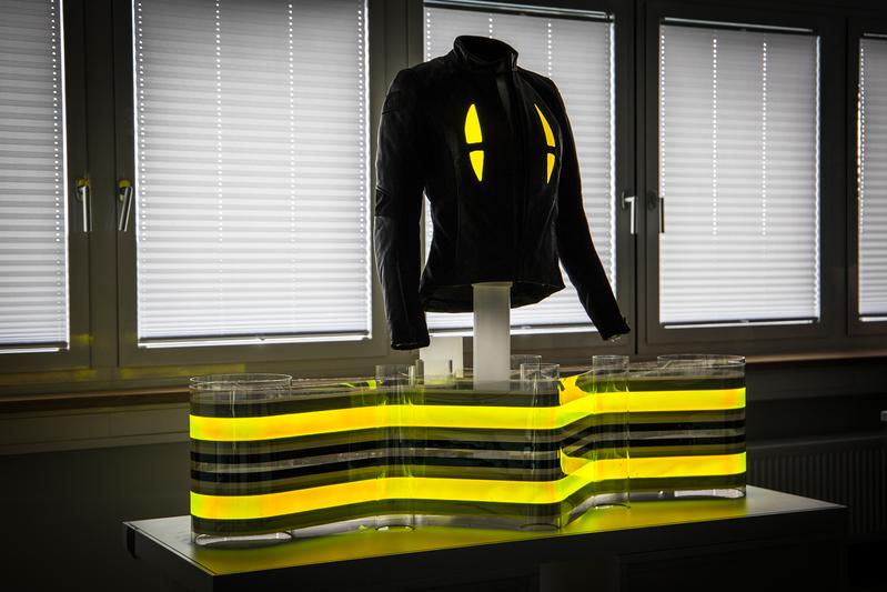 Motorcycle jacket with integrated flexible OLED